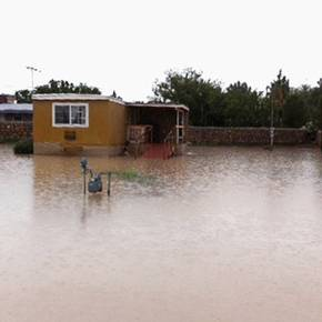 Colonias program promotoras help Socorro flooding victims