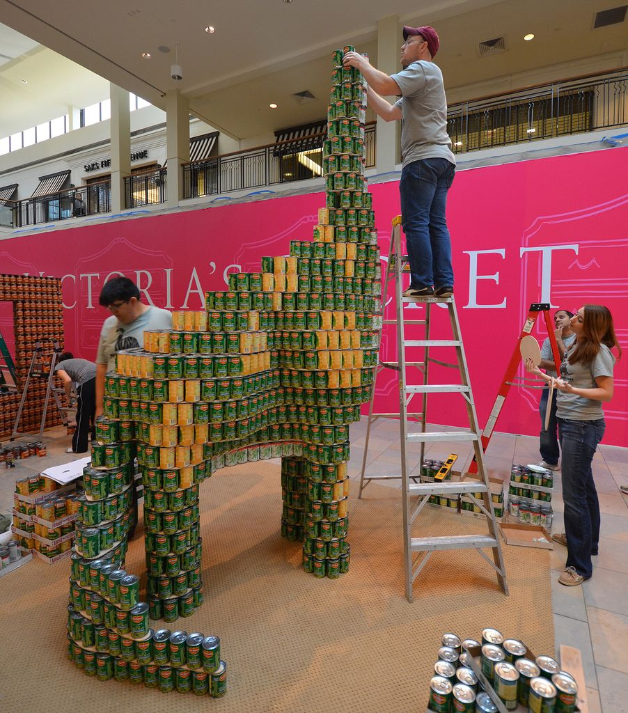 Students Help Firm Build Canned Food Dinosaur Sculpture